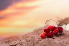 The heart candy flow out of glass royalty free stock photo