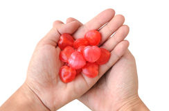 Heart Candy on Hands. Isolation Background Stock Photos
