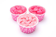 Heart candy in Pink polka dot paper cups  Royalty Free Stock Photos