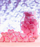Heart candy. Pink heart shape marshmallows is sweet dessert  in bottle on wooden table with bokeh background   for Valentine concept Royalty Free Stock Images