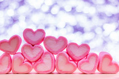 Heart candy. Pink heart shape marshmallows is sweet dessert  on wooden table with bokeh background   for Valentine concept Royalty Free Stock Image