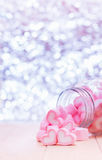 Heart candy. Pink heart shape marshmallows is sweet dessest in bottle with  bokeh background   for Valentine concept Royalty Free Stock Photo