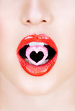 Heart candy in red lips..Heart candy in red lips. Royalty Free Stock Images