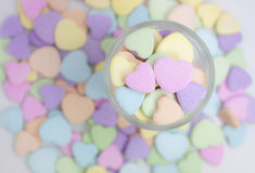 The heart candy. The heart shape candy in the glass on heart candy background Stock Photo