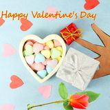 Heart with candy Valentine Background with red rose and happy valentine text in blue  background Royalty Free Stock Images