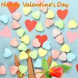 Heart with candy Valentine Background with red rose and happy valentine text in blue  background Stock Photo
