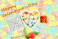 Heart with candy Valentine Background with red rose and happy valentine text in candy  background Stock Photography