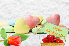 Heart candy Valentine Background with red rose and happy valentine text in snow background Royalty Free Stock Photo