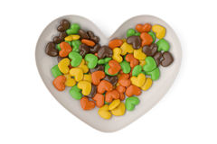 Heart candys on heart plate. 3D illustration Royalty Free Stock Image