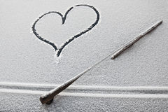 Heart on the car. Heart on the snow-covered car Stock Photo
