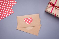 Heart card and gift in box with satin ribbon on gray background stock photography