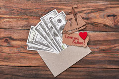 Heart on card near money. Stock Images