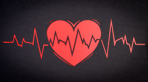 Heart cardiogram. On a black background paper Stock Photo
