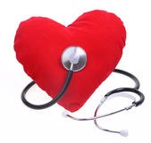 Heart care. Heart and stethoscope isolated on white with clipping path Royalty Free Stock Image