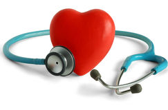 Heart care. Heart and a stethoscope isolated in white background