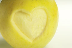 Heart carved into an apple Royalty Free Stock Images