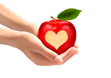 A heart carved into an apple. Royalty Free Stock Images