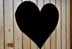 Heart. Carved out heart on the wooden door stock images