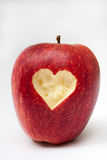 Heart carved into red apple Stock Images