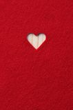 Heart carved in red felt Stock Photo