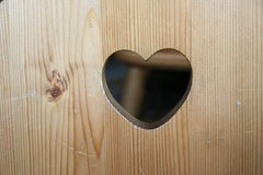 Heart carved in wood Stock Images