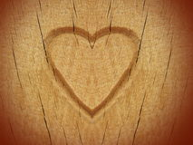 Heart carved on wood Stock Photo