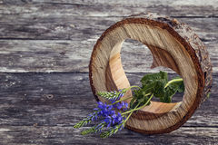 Heart carved in wood and violet flower on the old grunge boards. Stock Photo