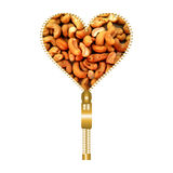 Heart with cashews. Heart shape made of golden zip, filled with cashews royalty free illustration