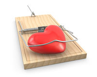 Heart caught in a mouse trap Stock Photography