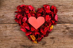 Heart in centre of red potpourri heart Stock Image