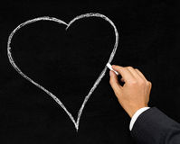 Heart chalk drawing on blackboard Royalty Free Stock Photos