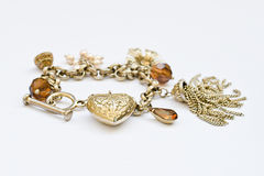 Heart charm bracelet with 5 charms isolated on white background Stock Photography