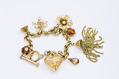 Heart charm bracelet with 5 charms isolated on white background Royalty Free Stock Photo