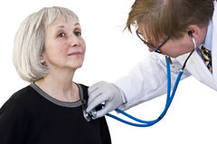 Heart Checkup. An attractive mature woman gets a heart checkup from her doctor Royalty Free Stock Photography