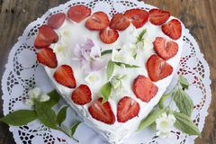 Heart Cheesecake with Strawberries Stock Photos