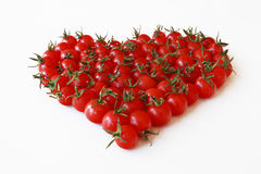 HEART OF CHERRY TOMATOES. Delicious and healthy cherry tomatoes ecologically grown, arranged in the form of heart Royalty Free Stock Photos
