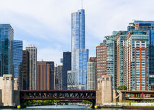 Heart of Chicago. Chicago, USA - May 24, 2014: Several skyscrapers in Downtown with Trump Tower in the middle and Lake Shore Drive Bridge over Chicago River in Stock Photo