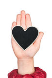 Heart in a child's hand with space for your text Royalty Free Stock Photo