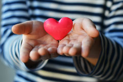 Heart in child`s hands Royalty Free Stock Photography