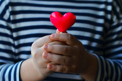 Heart in child`s hands Royalty Free Stock Photo