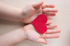 Heart at the children hands Stock Images