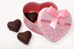 Heart of chocolate in the heart shaped gox with bow Stock Images
