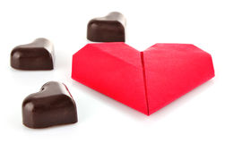 Heart of chocolate and origami Stock Photo