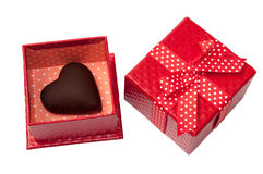 Heart of chocolate in the red gift box with bow Royalty Free Stock Images