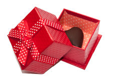 Heart of chocolate in the red gift box with bow Stock Photos