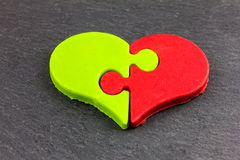 A heart of chocolate, with two different flavors. Matcha and strawberry Royalty Free Stock Photography