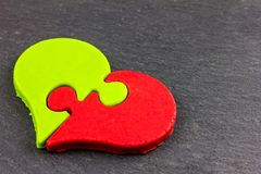 A heart of chocolate, with two different flavors. Matcha and strawberry Stock Photography