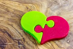 A heart of chocolate, with two different flavors. Matcha and strawberry Royalty Free Stock Images