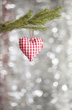 Heart Christmas Tree Ornament. Heart Christmas tree decoration on silver shiny background Stock Photo