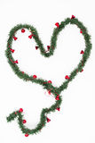 Heart of Christmas wreath with red little bells Stock Photos